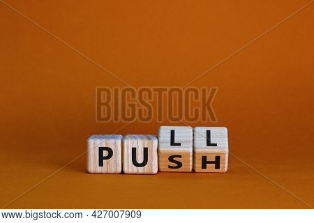 Pull Or Push Symbol. Turned Wooden Cubes And Changed The Word 'push' To 'pull'. Beautiful Orange Bac