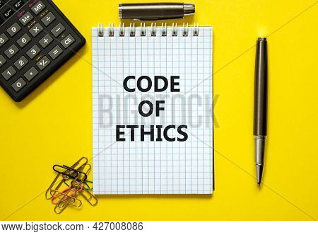 Code Of Ethics Symbol. Words 'code Of Ethics' On White Note. Yellow Background, Paper Clips, Metalli