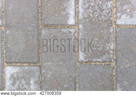 Gray Texture Of Paving Stones. Close-up Of Stone Tiles For Sidewalks. Top View