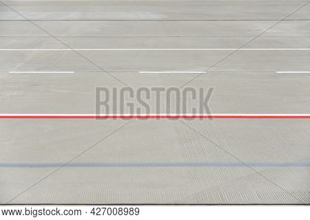 Texture Of Modern Airport Runway With Stripes