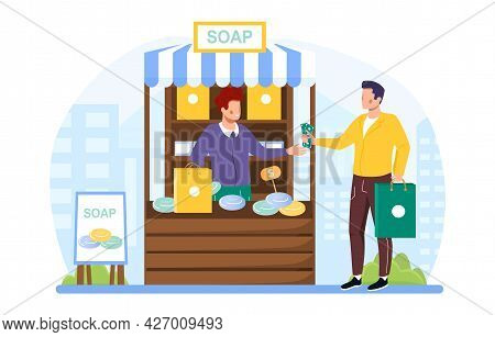 Handmade Soap Concept. A Woman Stands Behind The Counter And Sells A Man A Piece Of Soap Of Her Own