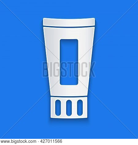 Paper Cut Tube Of Toothpaste Icon Isolated On Blue Background. Paper Art Style. Vector