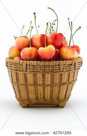 Rainier Cherries In A Wooden Basket