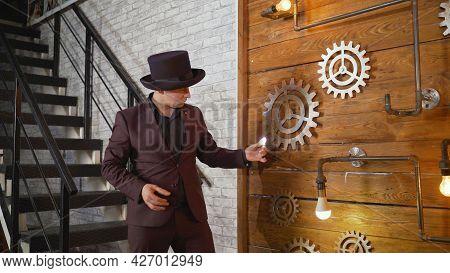 Magical Lighting Of A Light Bulb. Businessman Demonstrating Magic. Magician At Work. Entertainer Per