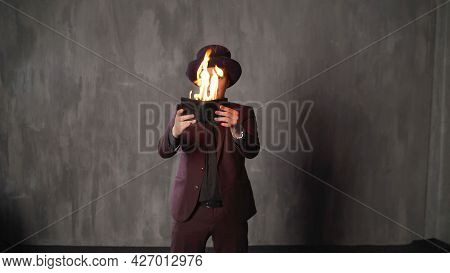 The Man Opens His Wallet. Bankruptcy, Poverty Concept. Money Is Burning. The Wizard Burns His Wallet