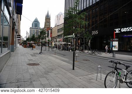Montreal, Qc, Canada - 7-15-2021: Sainte Catherine Street - People Walk And Enjoy Their Time At A Re