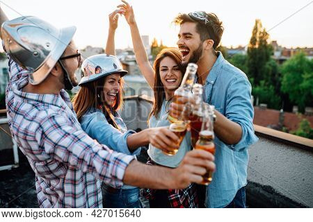 Happy Group Of Friends With Drinks Having Fun At Rooftop Party