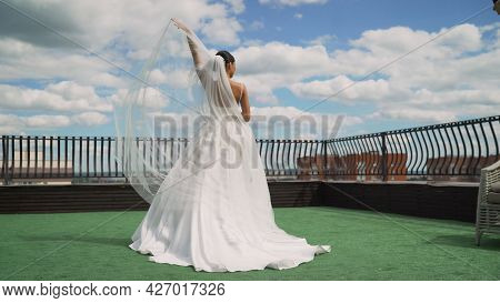 Young Brunette Sexy Girl Model Bride Wife In White Dress Stands On Top Of The Hotel. Bride In A Beau