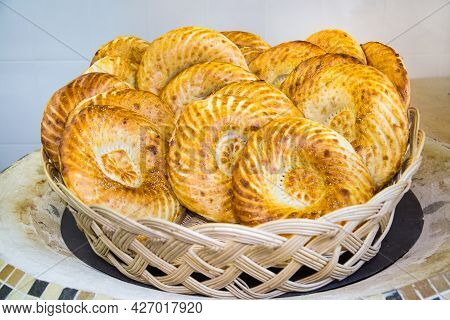 Uzbek Flatbreads With A Beautiful Pattern In A Wicker Basket On A Tandoor. Bakery Products National