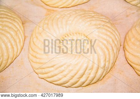 Molding Dough With A Beautiful Pattern For Baking Uzbek Flatbread. Bakery Products National Traditio