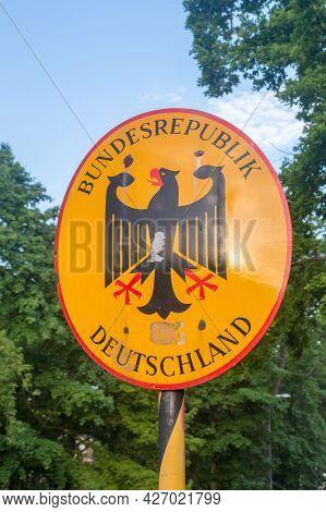 Gorlitz, Germany - June 2, 2021: Emblem Of Germany With Sign Bundesrepublik Deutschland With Eagle.
