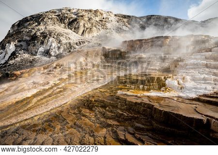 Terraces Of Mammoth Hot Spring Made By Calcium Carbonate Covered By Smoke From Hot Water, Yellowston