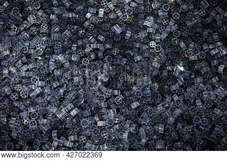 Close Focus On Black Plastic Pieces With Dirty Slime From Filtering Water From Fish Tank For Cleanin