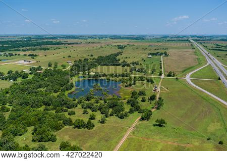 Aerial View Of Oil Pump In The Countryside The Small Pond Near Historic Road 66 In Clinton Oklahoma