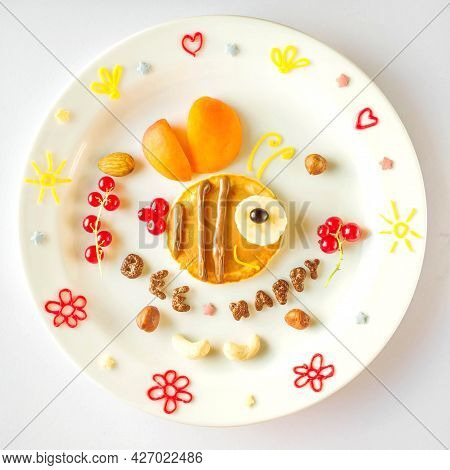 Edible Bee Made Of Pancake With Apricot And Currant For Kids. Plate With Funny Pancake. Funny Breakf