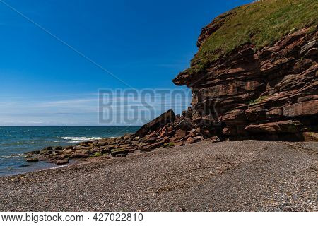 A Picture Showing A Cliff Face That Is Being Eroded By The See At St Bees In Cumbria England