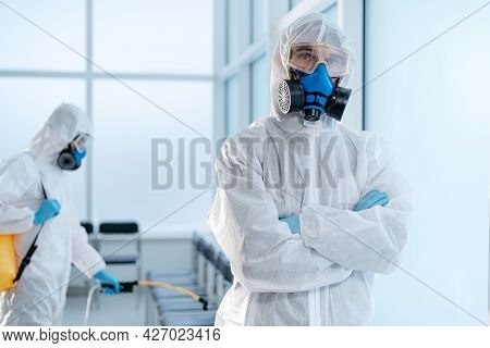 Team Of Professional Disinfector Standing In The Hospital Lobby .