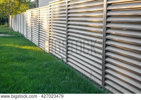 A Long Fence Along The Plot. Fenced Territory. Space For Text.