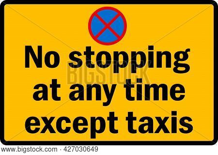 No Stopping At Any Time Except Taxis Sign. Black On Yellow Background. Traffic Signs And Symbols.