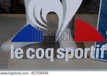 Toulouse , Occitanie France  - 06 25 2021 : Le Coq Sportif Logo And Text Sign On Sport Store French