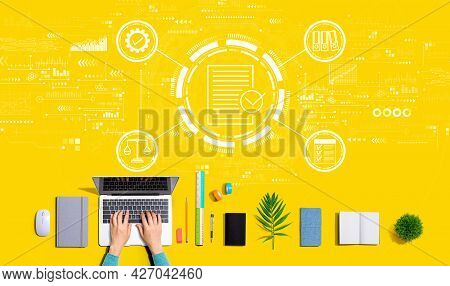 Compliance Concept With Person Using A Laptop Computer
