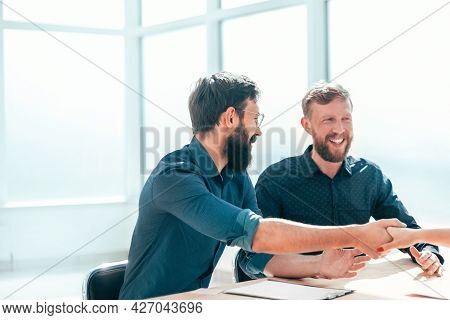 Employer Shaking Hands With A Young Woman During The Interview.