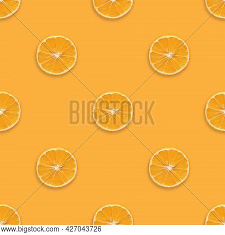 Seamless Pattern With Orange Fruit On Orange Background. Orange Slices Seamless Texture For The Desi