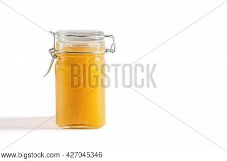 Homemade Yellow Jam In A Jar On A White Background. Fruit Jam. Space For Text.