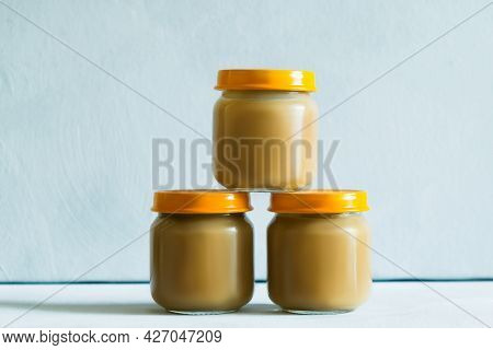 Three Jars Of Vegetable Or Fruit Puree. Baby Food, Childrens Complementary Food, Canned Goods Concep