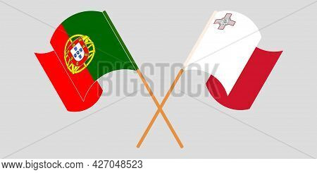 Crossed And Waving Flags Of Malta And Portugal