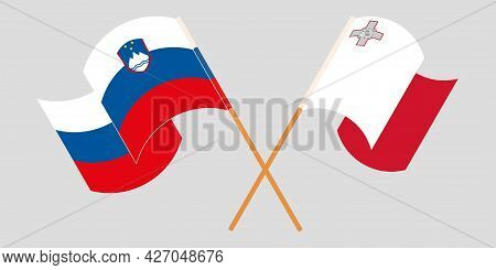 Crossed And Waving Flags Of Malta And Slovenia