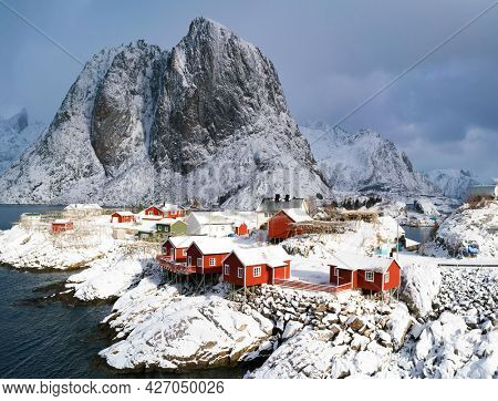 Traditional Norwegian fisherman houses,  on the island of Hamnoy, Reine on the Lofoten in northern Norway at winter.