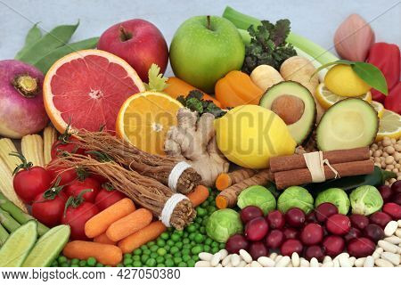 Healthy food for immune defense with fruit, vegetables, legumes, herbs and spice high in protein, anthocyanins, antioxidants, lycopene, carrotenoids, dietary fibre. Healthcare concept.