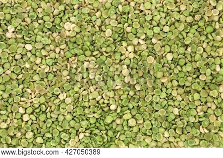 Roasted green peas high protein health food forming a background. High in dietary fibre, vitamins and minerals and  have many health benefits. Flat lay, top view.