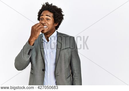 Young african american man wearing business jacket over isolated white background looking stressed and nervous with hands on mouth biting nails. anxiety problem.