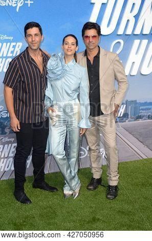LOS ANGELES - JUL 15:  Josh Peck, Lyndsy Fonseca, John Stamos at Disney+