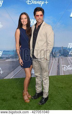 LOS ANGELES - JUL 15:  Caitlin McHugh, John Stamos at Disney+