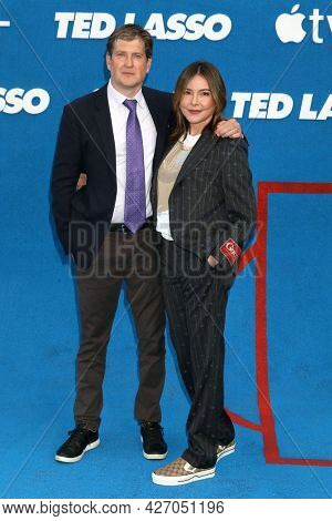 LOS ANGELES - JUL 15:  Bill Lawrence, Christa Miller at the Ted Lasso Season 2 Premiere Screening at the Pacific Design Center Rooftop on July 15, 2021 in Los Angeles, CA