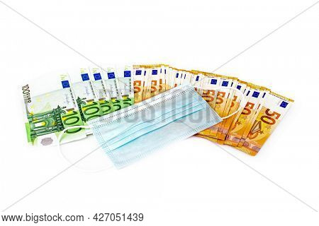 medical mask and hundred and fifty euro notes concept