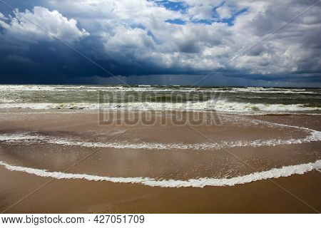 Lowering black clouds and storm on the Baltic Sea in bad weather.
