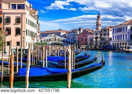 Beautiful amazing Venice town. Grand canal with godolas and Rialto Bridge. Italy. Nov.2020