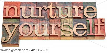 nurture yourself - inspirational word abstract in vintage letterpress wood type, self-care concept