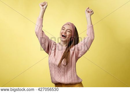 Positive Celebating Happy European Young Woman Wearing Casual Sweater Yelling Happily Shouting Yes,