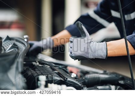 Portrait Of A Young Mechanic Holding A Wrench, Ready To Fix Cars. Repair Service.concept Of Car Insp