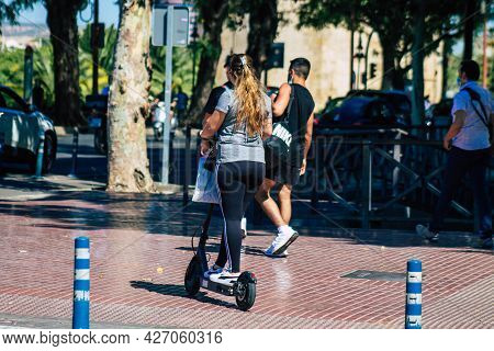 Seville Spain July 09, 2021 People Rolling With An Electric Scooter In The Streets Of Seville, Opera