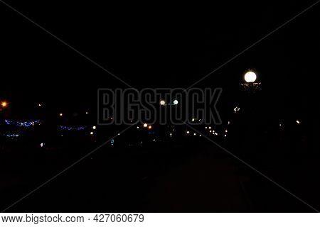 Luminous Street Lanterns In Park At Night