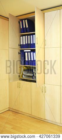 Blue And Yellow Files In A Wooden Cabinet In The Modern Office, Office Lifestyle