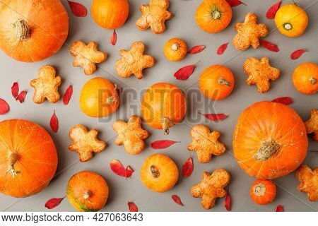 Pumpkin Spice Cookies And Fall Decor From Fresh Orange Pumpkins On Gray Background. Traditional Coff