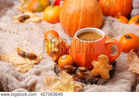Cup Of Pumpkin Spice Latte With Seasonal Autumn Spices, Gingerbread Man Cookies And Fall Decor From