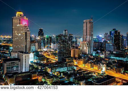 Night Cityscape And High-rise Buildings In Metropolis City Center . Downtown Business District In Pa